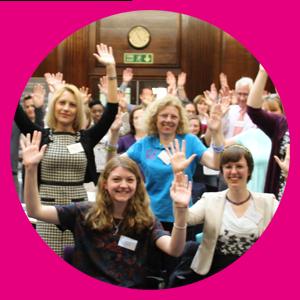 Group of happy people waving
